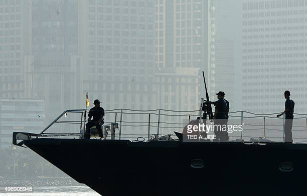 Philippine coastguard personnel aboard a patrol boat patrol near the site of Asia Pacific Economic Cooperation summit in Manila on November 13 as...