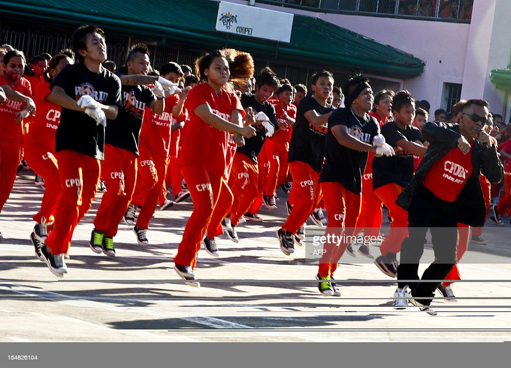 Philippine convicts dance to the tune of the horse-riding dance 'Gangnam Style' made famous by South Korean rapper Psy during a performance for visitors and toruists at the Provincial Detention and Rehabilitation Center in Cebu on October 27, 2012. Philippine convicts who became famous for dancing to Michael Jackson's hits have added South Korean spice to their repertoire, with a performance of the popular 'Gangnam Style' rap. AFP PHOTO