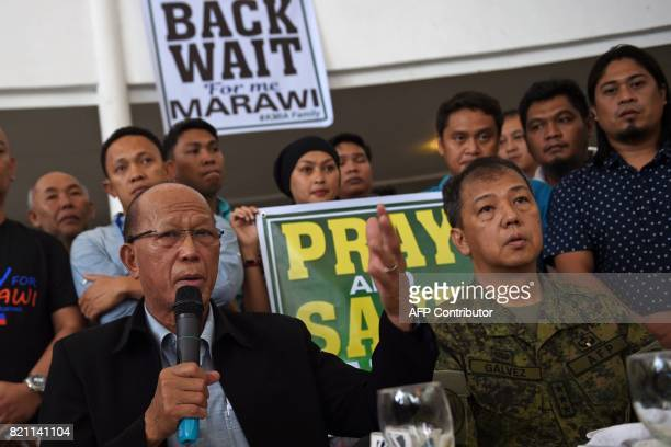 Philippine Defense Secretary Delfin Lorenzana speaks while Lieutenant General Carlito Galvez Western Mindanao military commander listens during a...