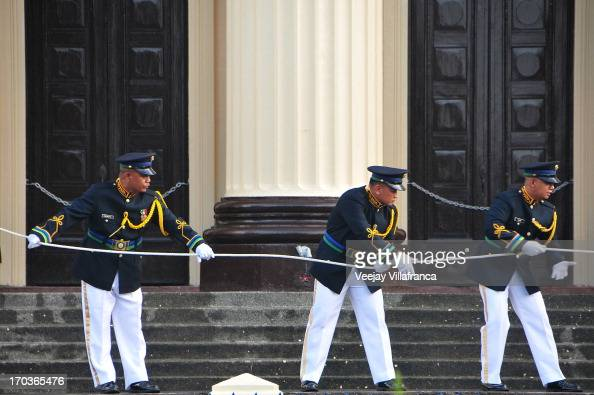 Philippine honor guards rehearse the flag raising in preparation for the 115th anniversary of Philippine Independence on June 12 2013 in Manila...