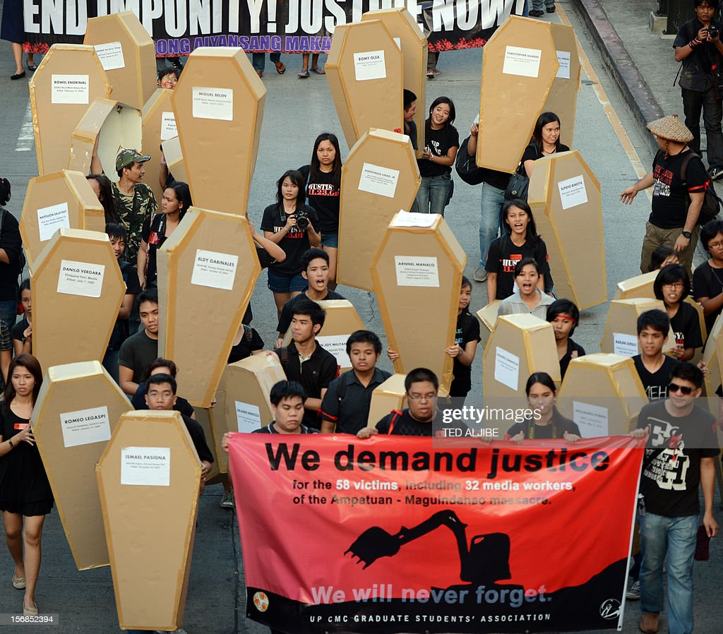 Philippine journalists and students carry mock coffins as they march towards Malacanang Palace in Manila on November 23, 2012, to commemorate the third anniversary of the November 23 Maguindanao massacre. Dozens of members of a clan whose leaders are on trial for the Philippines' worst political massacre are candidates in 2013 elections, some for the president's party, media and rights groups said November 23. The revelations sparked outrage on the three-year anniversary of the massacre, in which 58 people died, with critics saying the Ampatuan family's enduring political influence underlined the country's 'culture of impunity'.