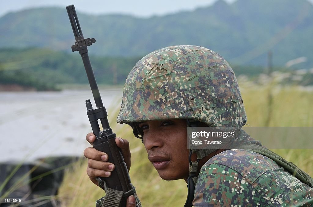Philippine Marine soldier looks on during a military training exercise in Crow Valley, September 21, 2013 in Tarlac province, Philippines. Around three thousand U.S. Marines are in the country for the Phiblex amphibious marine exercise with their Philippine counterparts. The war games maneuvers run for three weeks in various locations in the Philippines.