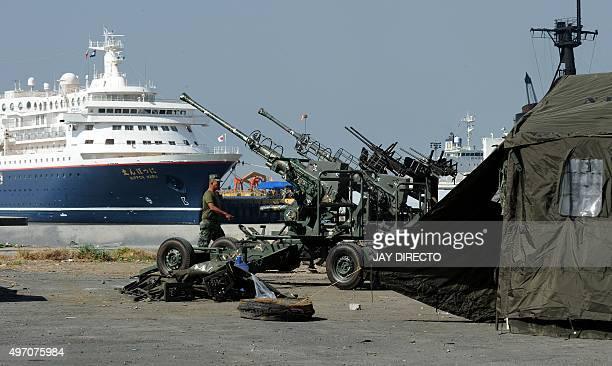 A Philippine marine walks beside antiaircraft guns in Manila on November 14 ahead of the AsiaPacific Economic Cooperation summit The Philippines...