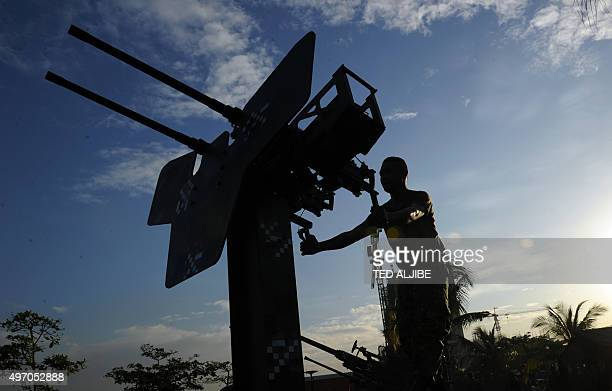 A Philippine marines adjust antiaircraft guns deployed near the site of the AsiaPacific Economic Cooperation summit as part of security preparations...