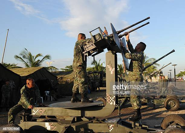 Philippine marines adjust antiaircraft guns deployed near the site of the AsiaPacific Economic Cooperation summit as part of security preparations in...