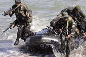 Philippine Marines and counterparts from the US Marines' 31st Marine Expeditionary Unit of the 3rd Marine Expeditionary Forces and their Philippine...