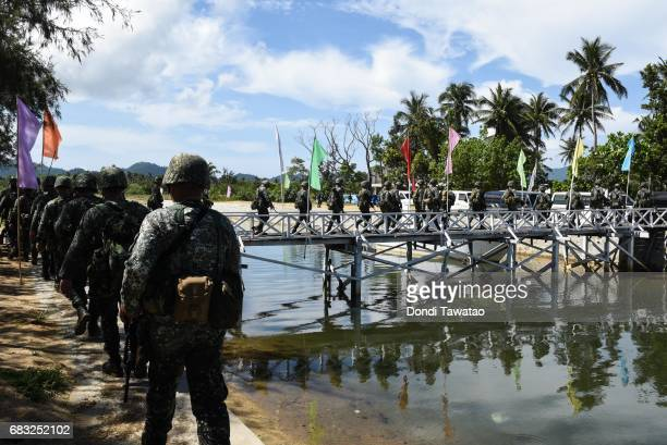 Philippine marines cross a bridge after disembraking from a beach on May 15 2017 in Casiguran Province Philippines Philippines and US troops held the...