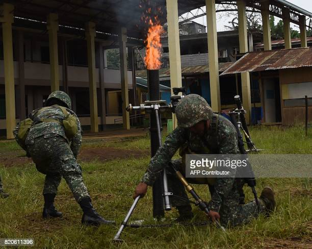 Philippine Marines fire 81mm mortars at Muslim militant positions at the frontline in Marawi on the southern island of Mindanao on July 22 2017 The...