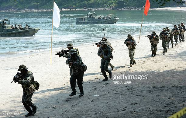Philippine Marines simulate a beach landing exercise as part of their annual joint naval exercises with the US at a marine base in Ternate Cavite...