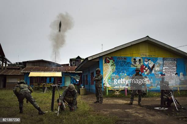 Philippine Marines soldiers firing mortar rounds towards enemy positions on July 22 2017 in Marawi southern Philippines The Philippine Congress voted...
