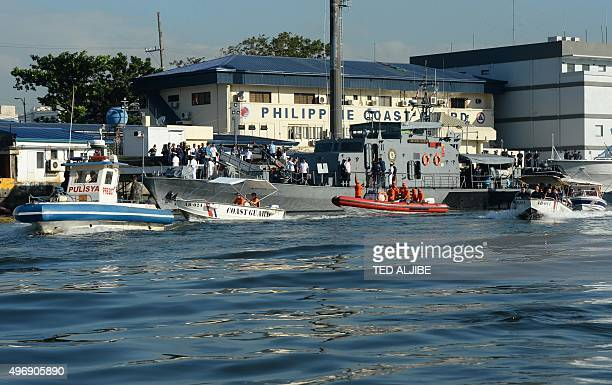 Philippine maritime police navy and coastguard personnel aboard their boats prepare to patrol near the site of Asia Pacific Economic Cooperation...