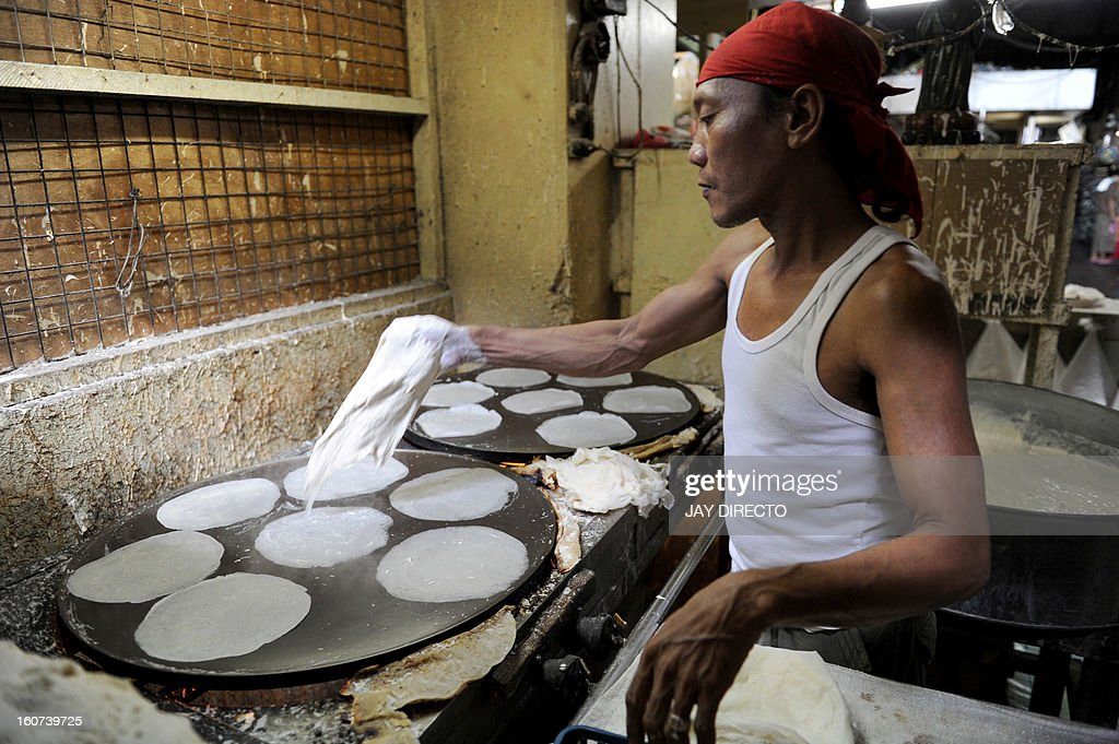Philippine market vendor Romualdo Flores, 47, makes spring roll flour wrappers at his shop in Manila on February 5, 2013. Flores has been producing at least 10,000 wrappers a day for the last 20 years, earning around 600 pesos (15 USD) daily. Inflation rate in the Philippines rose to 3.0 percent in January, slightly higher than the 2.9 percent the previous month following a rise in prices of goods and services. AFP PHOTO / Jay DIRECTO