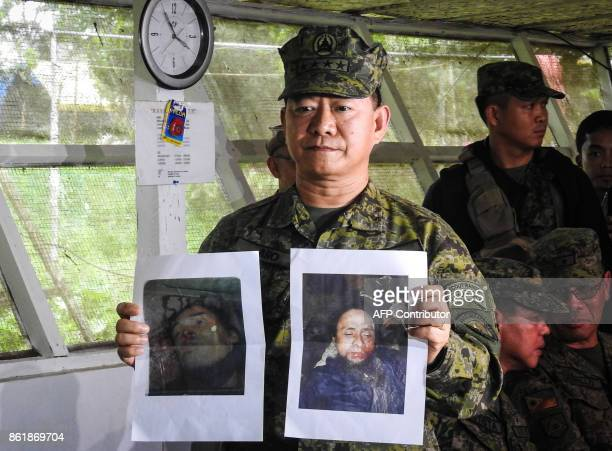 Philippine military chief General Eduardo Ano shows images of Islamic militant leaders Isnilon Hapilon and Omarkhayam Maute during a press conference...