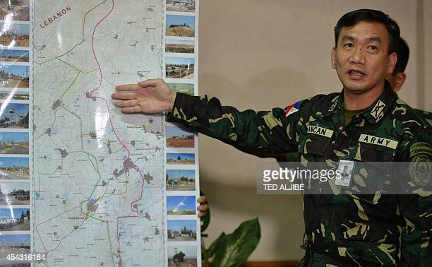Philippine military Colonel Roberto Ancan commanding officer of the peace keeping operation center points to a map of the Golan Heights where...