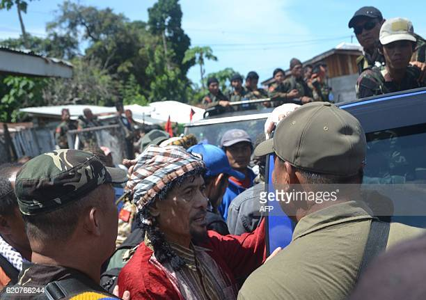 Philippine Muslim rebel leader Nur Misuari of the Moro National Liberation Front talks to his troops as he arrives at the airport in Jolo town in...