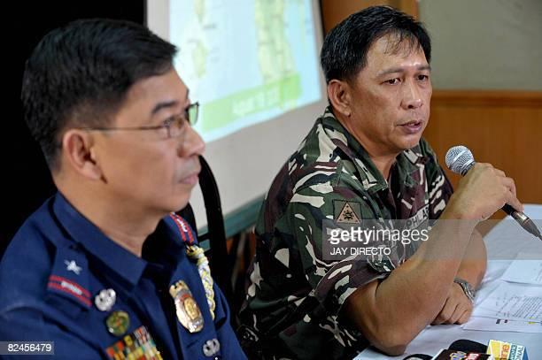 Philippine National Police spokesman Chief Superintendent Nicanor Bartolome looks on as his military counterpart Brigadier General Jorge Segovia...