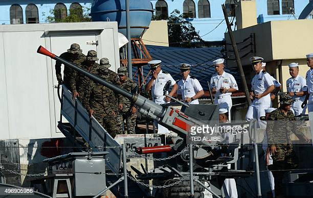 Philippine navy personnel board a patrol boat as they prepare to patrol near the site of Asia Pacific Economic Cooperation summit in Manila on...