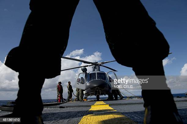 A Philippine Navy personnel stands in front of an Agusta Westland AW109 helicopter before it takes off during the bilateral maritime exercise between...