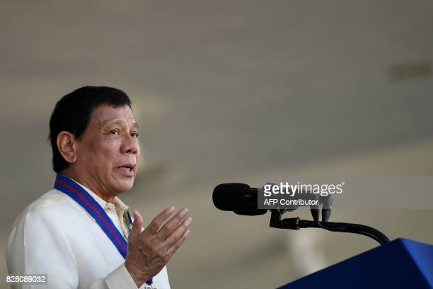 Philippine Philippine President Rodrigo Duterte gestures as he gives a speech during the 116th anniversary of the Philippine National Police at its...