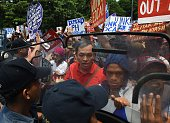 Philippine policemen try to block activists from marching to the US embassy during a protest to coincide with US Secretary of State John Kerry's...