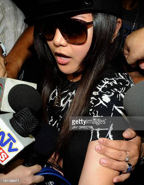 Philippine pop star Charice arrives to attend the wake of her father in Manila on November 2 after he was stabbed to death with an ice pick in a...