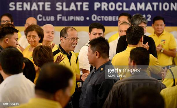 Philippine President Benigno Aquino arrives during the senate slate proclamation of the administration's senatorial lineup for the 2013 elections at...