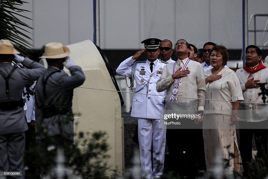 Philippine President Benigno Aquino III observes the singing of the national anthem at the Bonifacio Monument Circle in Caloocan city Metro Manila...