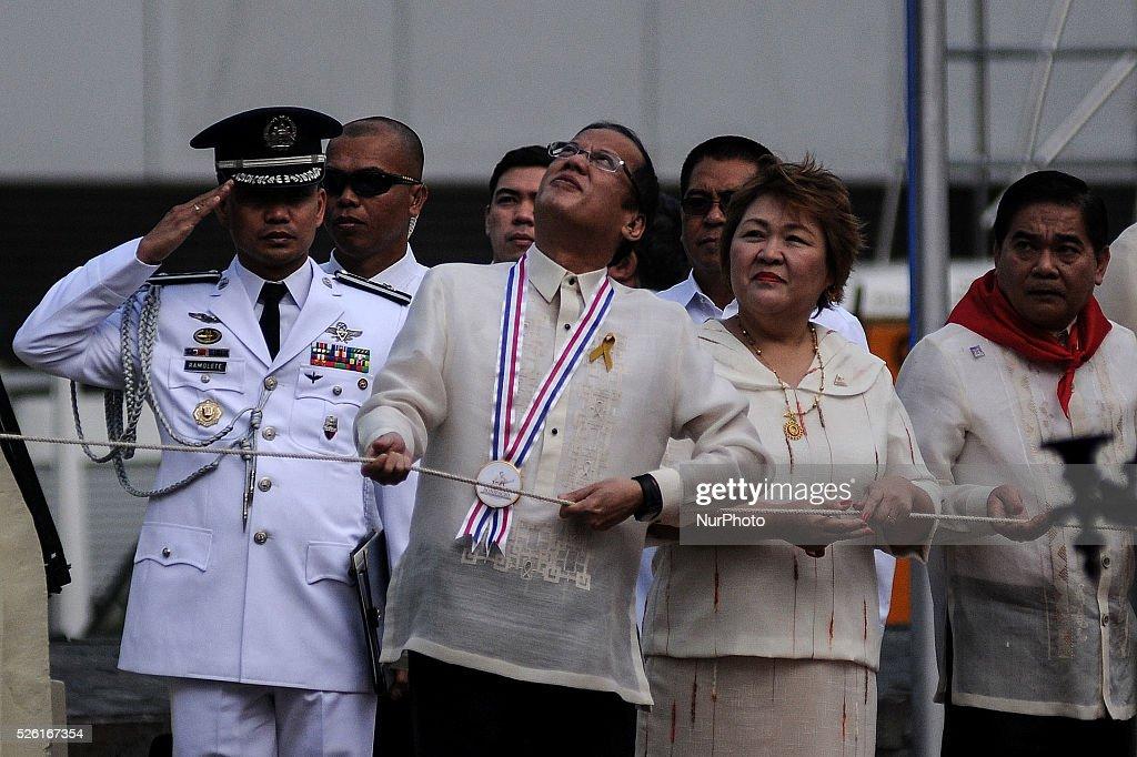Philippine President Benigno Aquino III pulls the rope during a flag raising ceremony at the Bonifacio Monument Circle in Caloocan city Metro Manila...