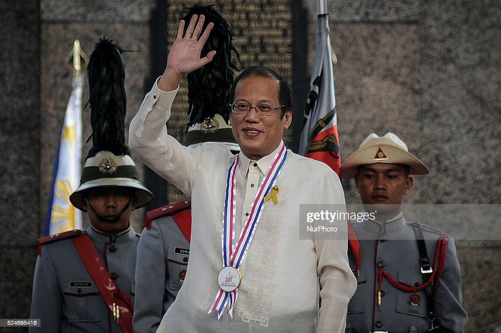 Philippine President Benigno Aquino III waves to the crowd during a ceremony marking Filipino nationalist Andres Bonifacio's 150th birth anniversary...