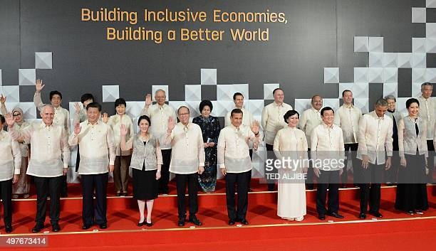 Philippine President Benigno Aquino is joined by leaders and their spouses for a leaders' 'family photo' at the AsiaPacific Economic Cooperation...