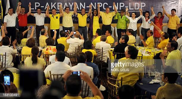Philippine President Benigno Aquino links hands with the administration's senatorial lineup for the 2013 polls Senator Antonio Trillanes Senator...