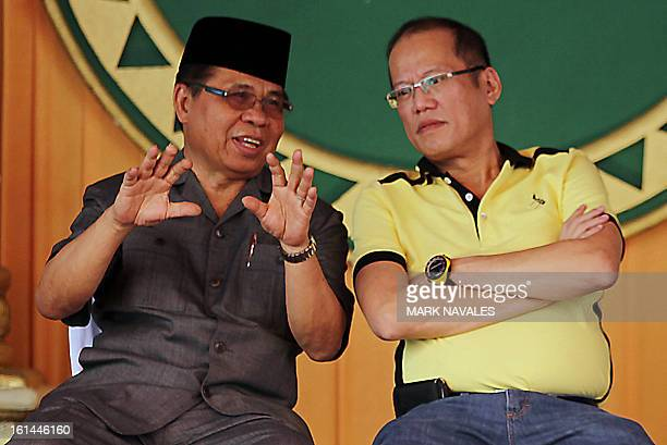 Philippine President Benigno Aquino listens as Moro Islamic Liberation Front chief Murad Ebrahim speaks during a meeting at the rebels stronghold in...