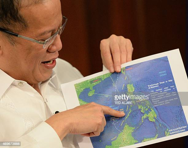 Philippine President Benigno Aquino points to a copy of China's ninedash line map during an interview with AFP at Malacanang Palace in Manila on...