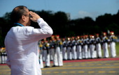 Philippine President Benigno Aquino salutes to the honour guards during the 77th anniversary celebration of the Armed Forces of the Philippines at...