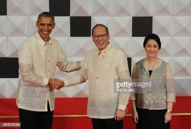 Philippine President Benigno Aquino shake hands with US President Barack Obama upon arrival as Aquino's sister Maria Elena Cruz looks on ahead of a...