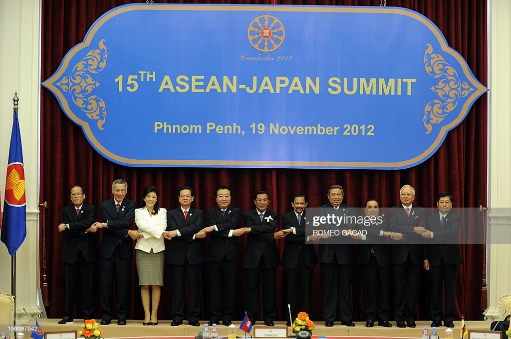 Philippine President Benigno Aquino, Singapore Prime Minister Lee Hsien Loong, Thai Prime Minister Yingluck Shinawatra, Vietnamese Prime Minister Nguyen Tan Dung, Japan Prime Minister Yoshihiko Noda, Cambodian Prime Minister Hun Sen, Brunei Sultan Hassanal Bolkiah, Indonesian President Susilo Bambang Yudhoyono, Laos Prime Minister Thongsing Thammavong, Malaysian Prime Minister Najib Razak and Myanmar Deputy Foreign Minister Kan Zaw join hands together for a family photo session during the Association of Southeast Asian Nations (ASEAN) and Japan summit in Phnom Penh on November 19, 2012 following the 21st ASEAN Leaders Summit.