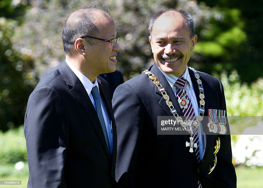 Philippine President Benigno Aquino (L) walks with the Governor General of New Zealand Lieutenant General Jerry Mateparae (R) during a state welcome at Government House in Wellington on October 23, 2012. Aquino is in New Zealand on a two-day visit before heading to Australia.
