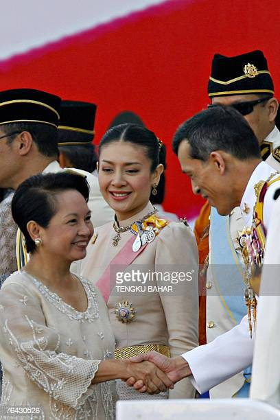 Philippine President Gloria Arroyo shakes hands with Thailand's Crown Price Maha Vajiralongkorn as his royal consort Princess Srirasmi looks on as...
