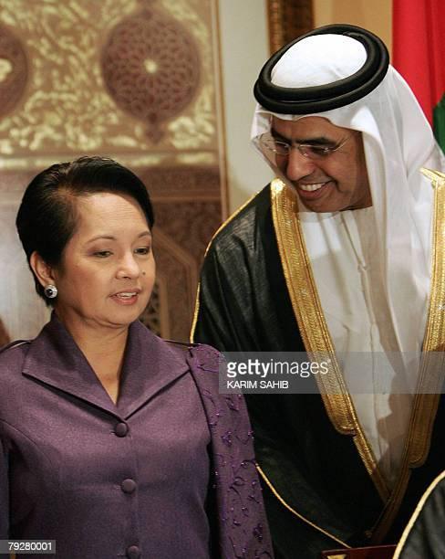 Philippine President Gloria Arroyo speaks with Humaid alTayer Chairman of the Dubai Chamber of Commerce 27 January 2008 in Dubai Arroyo urged Emirati...