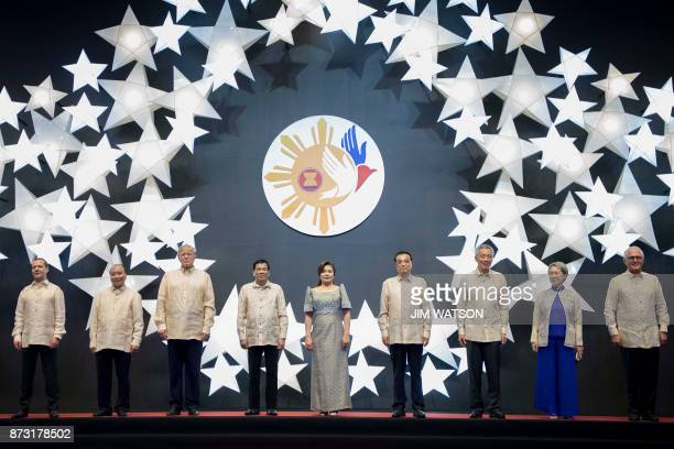 Philippine President Rodrigo Duterte and his partner Honeylet Avancena pose for a family photo with US President Donald Trump and other leaders...