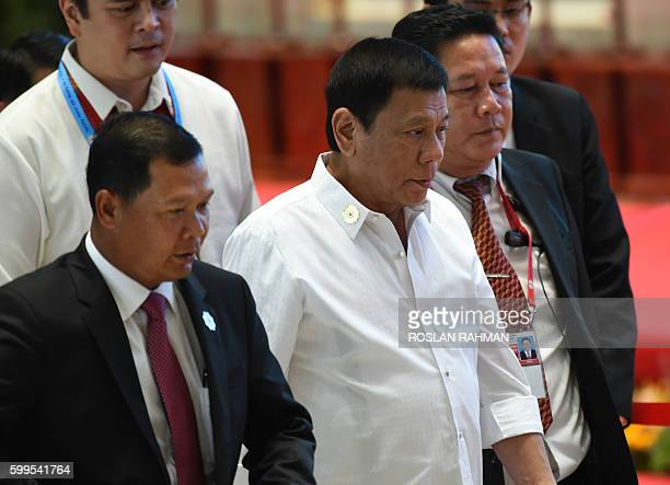 Philippine President Rodrigo Duterte arrives at the convention centre to attend the 28th and 29th Association of Southeast Asian Nations in Vientiane...