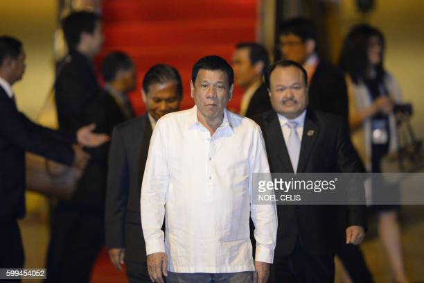 Philippine President Rodrigo Duterte arrives at the Wattay International Airport in Vientiane on September 5 2016 for the 28th Association of...