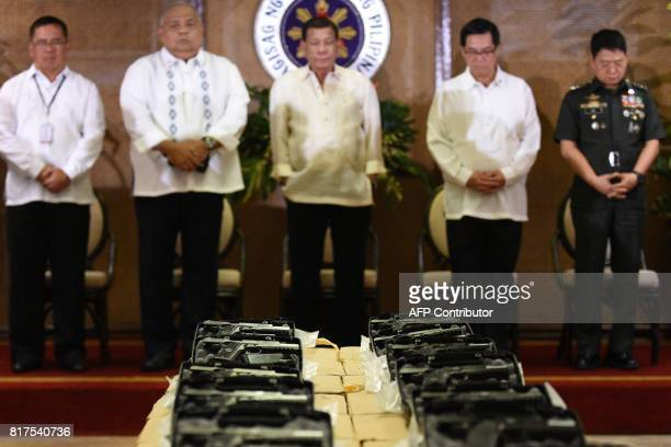Philippine President Rodrigo Duterte attends a ceremonial handover of some 3000 45 caliber handguns to the military at Malacanang Palace in Manila on...