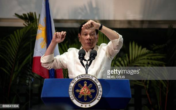 Philippine President Rodrigo Duterte gestures as he answers questions from the press at Manila International Airport on March 23 2017 Duterte warned...