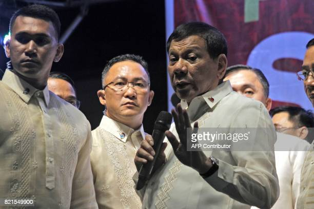 Philippine President Rodrigo Duterte gestures as he talks to protesters outside the House of Representatives after delivering his state of the nation...