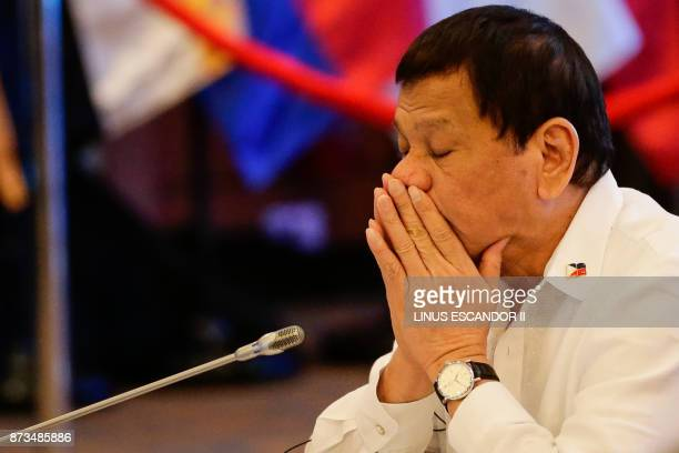 Philippine President Rodrigo Duterte gestures during the 20th ASEAN China Summit on the sideline of the 31st Association of Southeast Asian Nations...