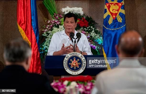Philippine President Rodrigo Duterte gives a speech during Eid alFitr celebrations at the Malacanang Palace in Manila on June 27 2017 / AFP PHOTO /...