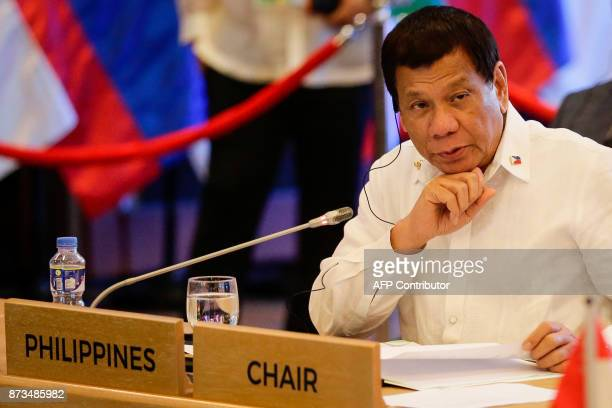 Philippine President Rodrigo Duterte looks on during the 20th ASEAN China Summit on the sideline of the 31st Association of Southeast Asian Nations...