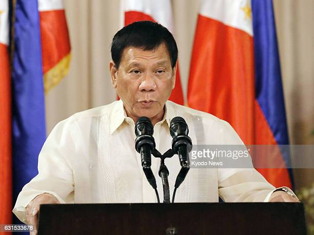 Philippine President Rodrigo Duterte speaks at a joint news conference with Japanese Prime Minister Shinzo Abe following their talks at the...