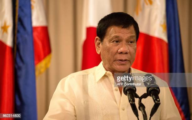 Philippine President Rodrigo Duterte speaks during a joint press statement with Japanese Prime Minister Shinzo Abe at the Malacanang Palace in Manila...